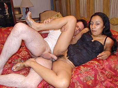Tina is all about wearing sexy clothes and presenting herself to her horny lover Here shes wearing a sexy black corset and sheer thong that clearly shows off her hairy beaver She spreads wide so her lover could tongue lash her hot hairy pussy